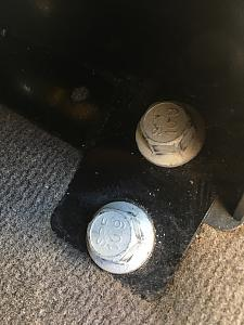 Bolts holding seats to floor.jpg