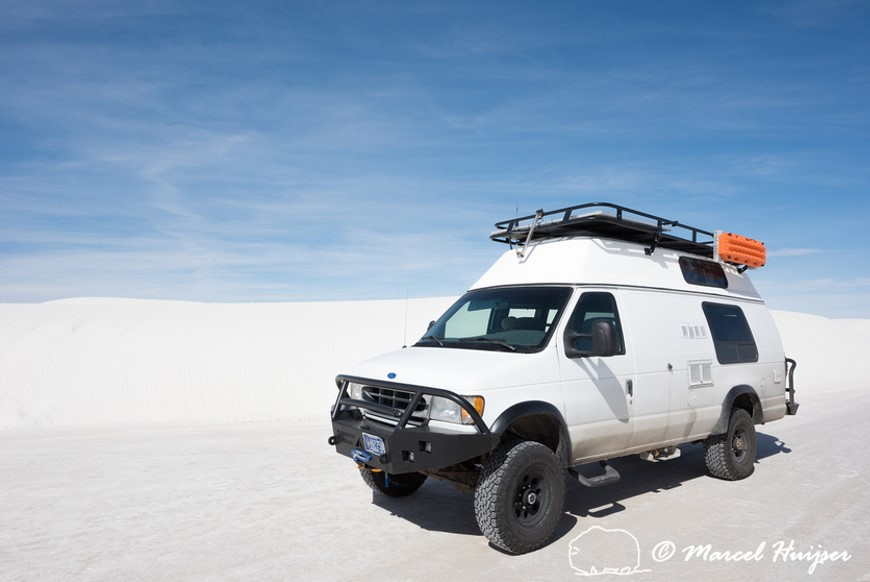 Camo mode  Camper van 4x4 on dirt road, White Sands National Monument, New Mexico, USA