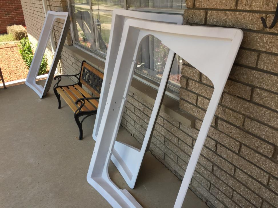 Painted the beige rear window trims white. These seem kind of janky. I think I have to keep them though, otherwise it will be too tricky to frame and panel around the windows with the wall curve and angled windows. If anyone has a picture of their own window framing for a window like this, I'd love to see it.