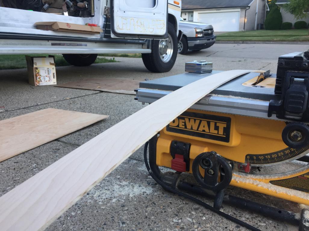 """Cutting 1/4"""" strips of birch for van floor grooves."""