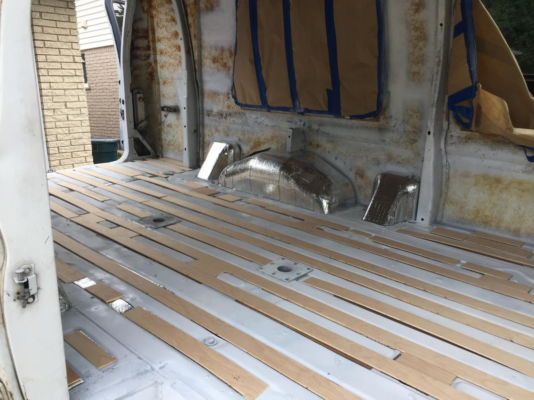 """Installing 1/4"""" birch slits in van floor grooves on top of Noico 80mil sound deadener. The combo makes for a near level floor surface- I want to reduce any chance of 1"""" rigid iso board insulation from compressing."""