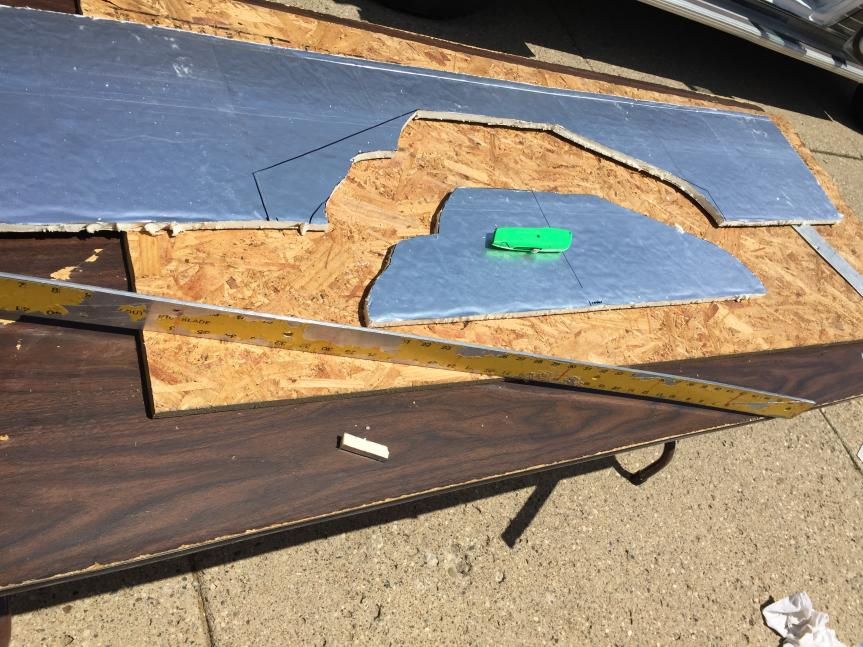 """Created cardboard templates and many measurements to cut 1/2"""" rigid iso board insulation for side walls."""