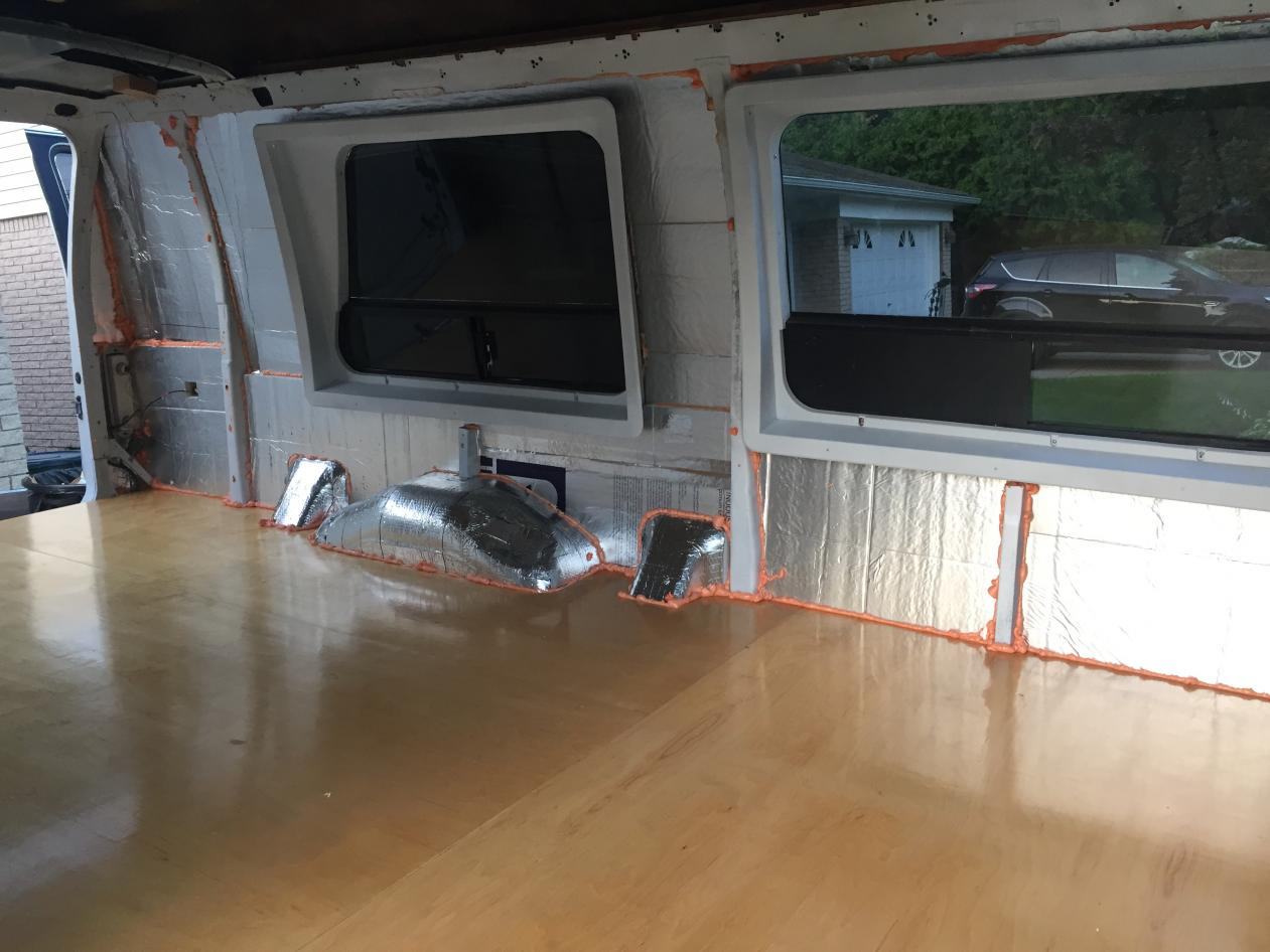 """Side wall insulation complete. 1"""" thickness everywhere with 2 pieces of 1/2"""" rigid iso board. An additional 1"""" (2"""" total) on lower 1/3 of the wall where there is more space. Adhered with Great Stuff Pro. All seems taped with foil tape and gaps and cracks sealed with Great Stuff Pro."""