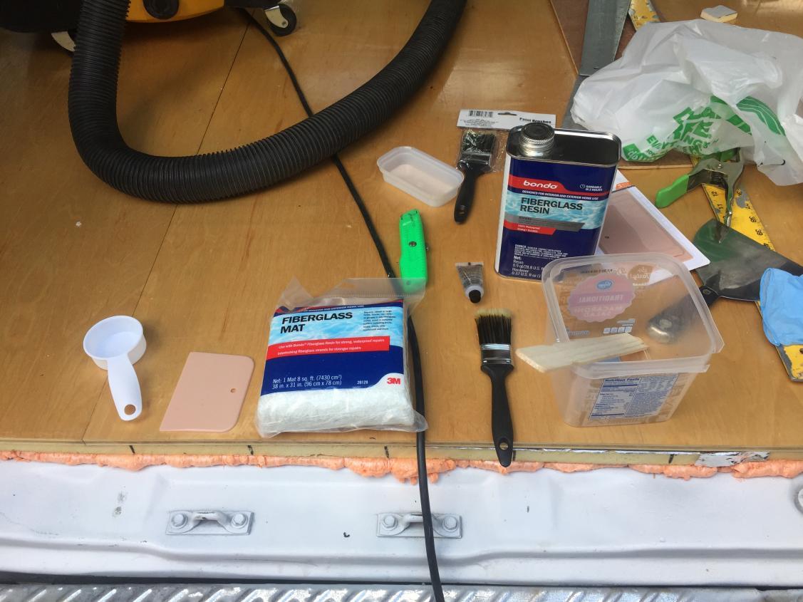 Bondo fiberglass resin kit and materials.