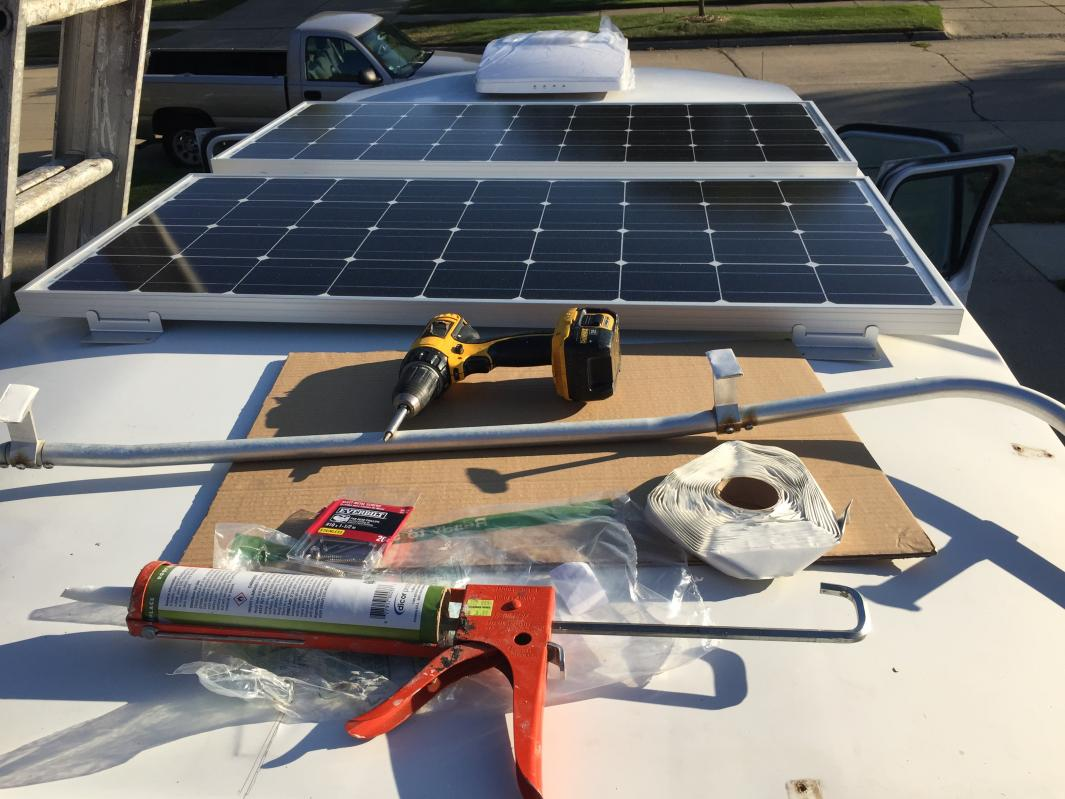 Installing solar panels and reinstalling luggage rack with stainless steel screws and Dicor butyl tape
