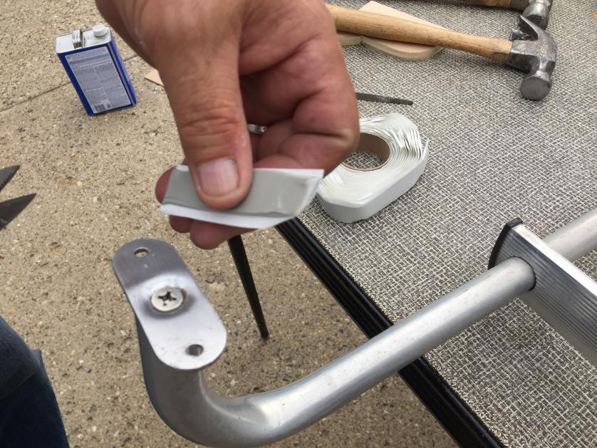 Reinstalling rear door ladder with stainless steel screws and Dicor Butyl tape.