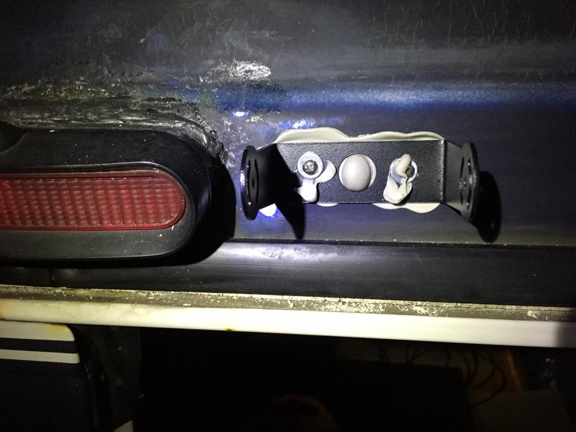 Rear backup camera bracket with Dicor Butyl tape.