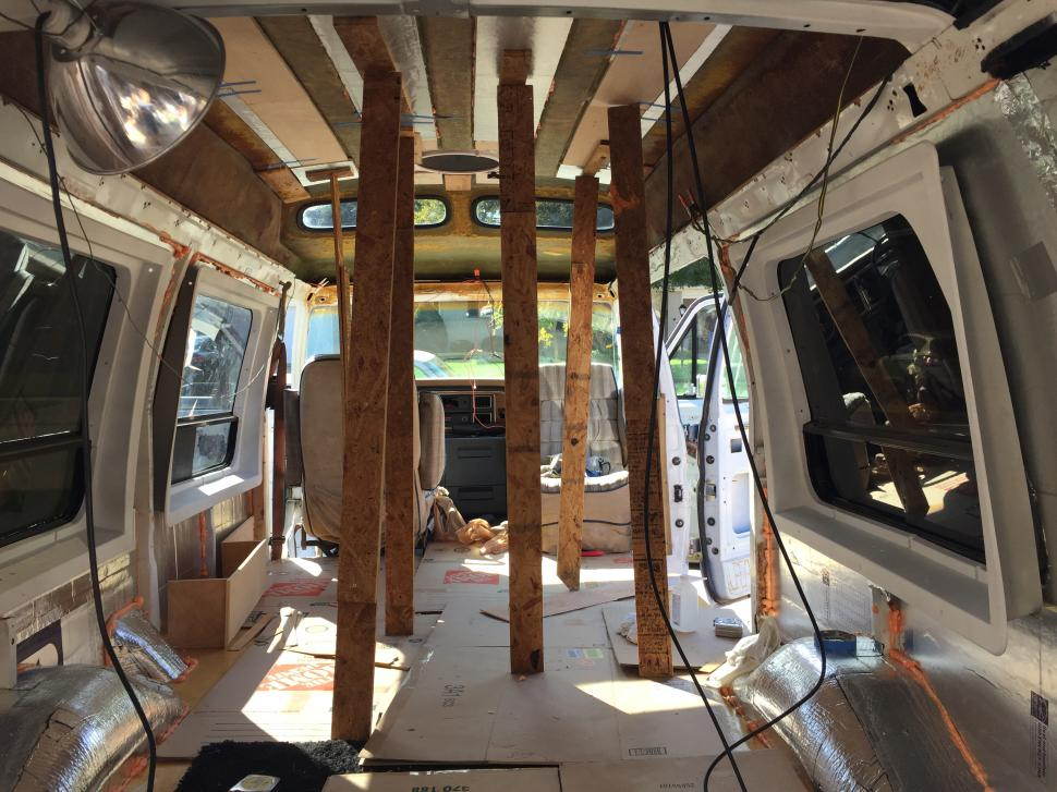 """Ceiling insulation. Strips of 1/2"""" Rigid Polyiso board adhered with Greatstuff Pro. Braced with strips of scrap plywood for curing."""
