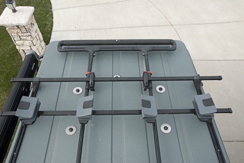 Yakima Showboat roller system. The roller slides from side to side and slides back over the end of the penthouse to assist in loading and unloading the kayaks.