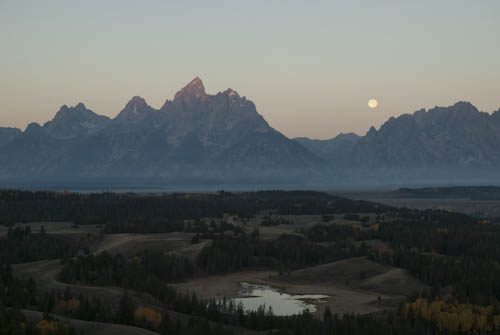 Full moon setting over the Tetons with Hedrick Pond below.