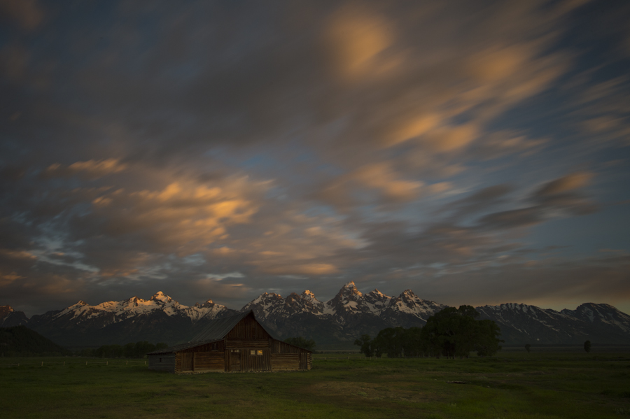 Sunrise with the Moulton Barn in the foreground, Grand Teton National Park.