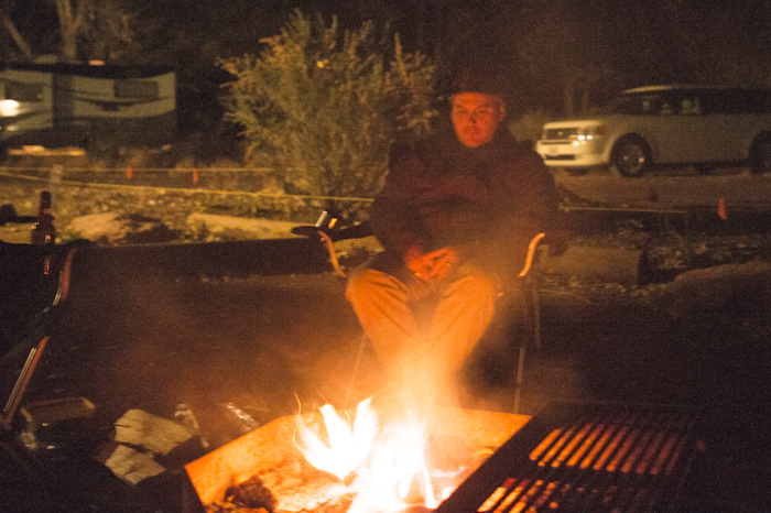 Waymon sitting at the campfire at the Watchman Campground in Zion National Park.