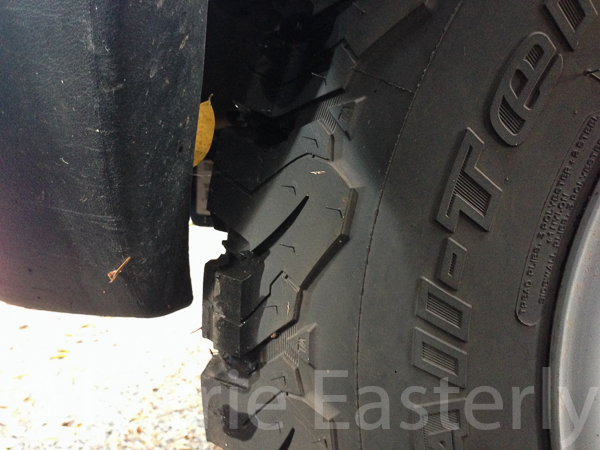 Driver side tire to front bumper clearance is a bit more than 1/2""