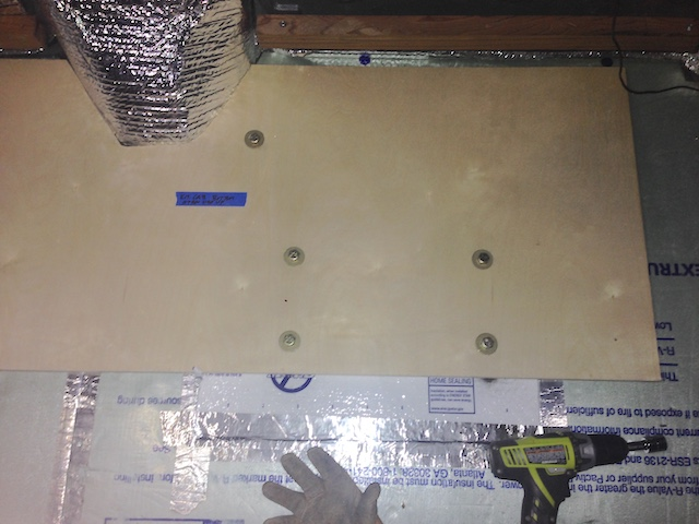 Kitchen cabinet base bolted to floor using factory seat mounting holes.