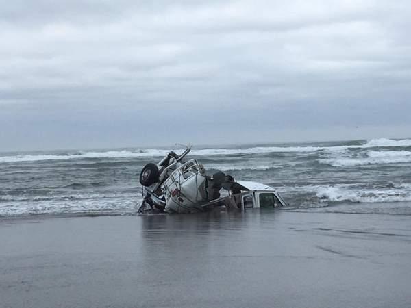 Van caught in the surf